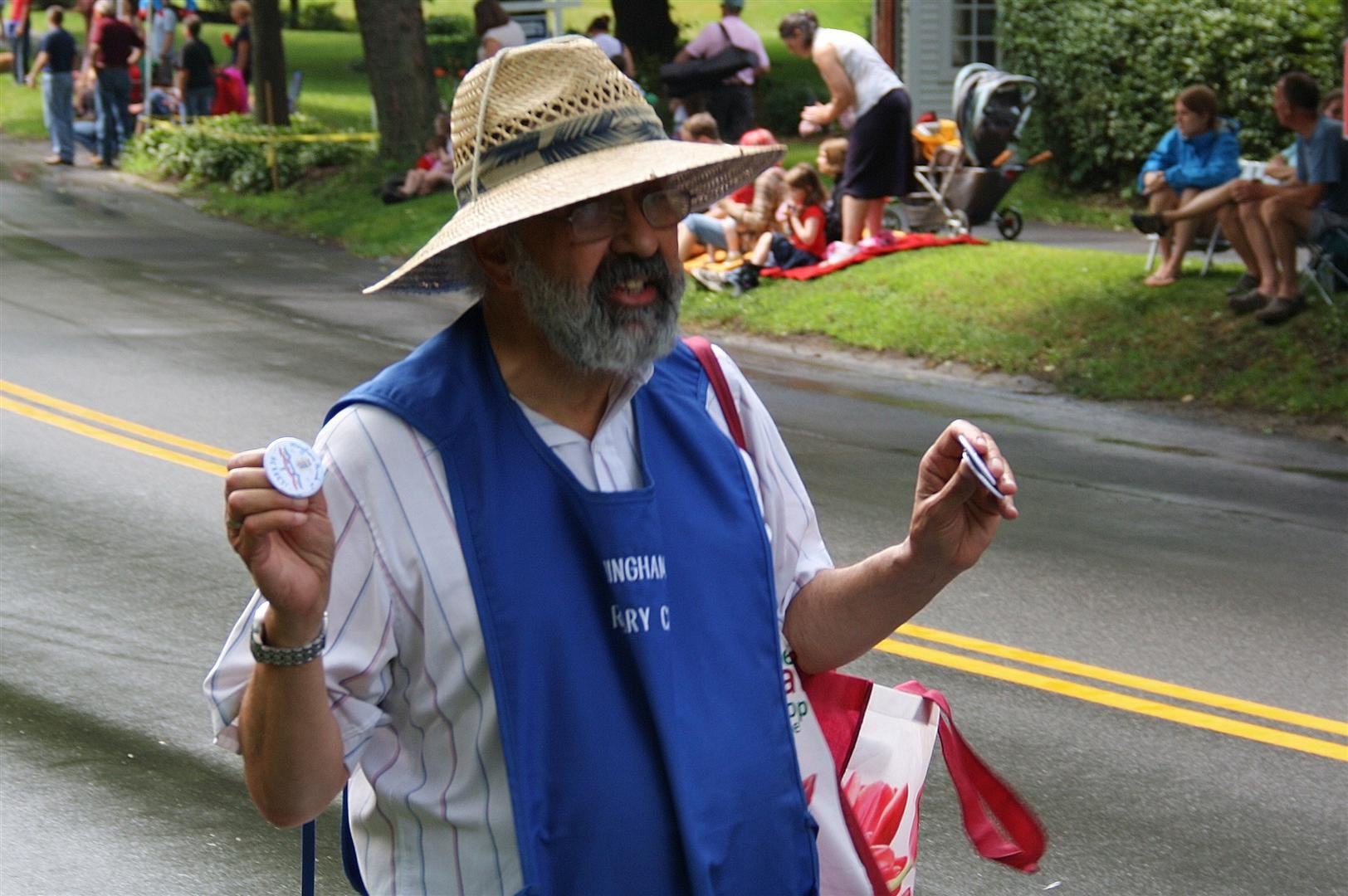 Members of the Hingham Rotary sell parade buttons