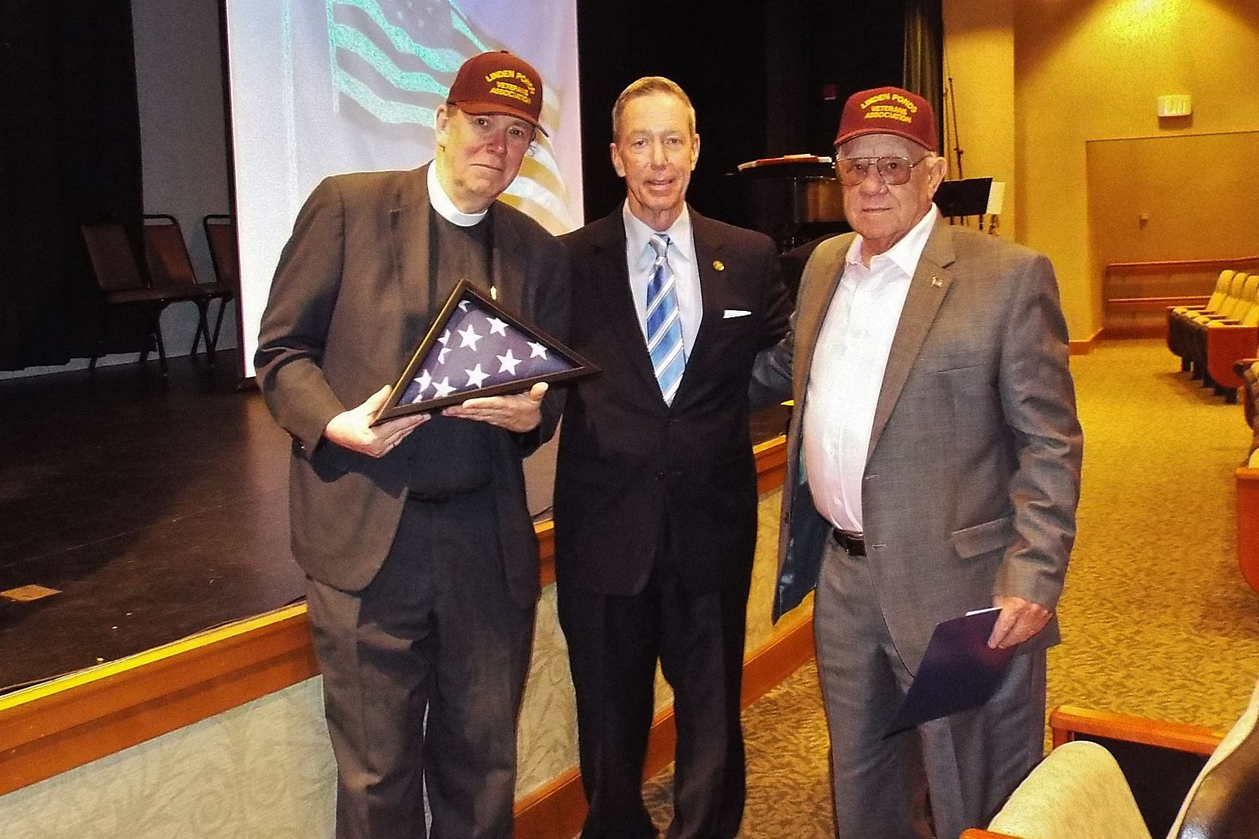 Pastoral Minister of LP and John Pinto-President of LP Veterans accept a flag flown over the Capital, Washington, DC from Congressman Stephen Lynch.